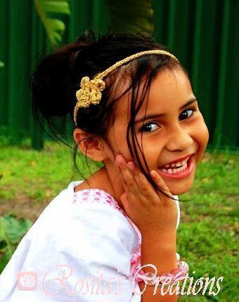 Kota wearing Innocent Flower in gold
